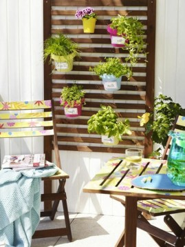 colorful-herb-pots-as-wall-decoration